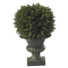 Brimming with natural inspiration, this faux cedar topiary adds verdant appeal to your entryway or home office.   Product: Faux top...