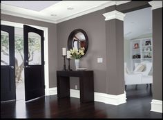 dark wood, gray walls and white trim..