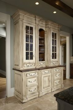 Love the distressed cabinet color...want this in my new home.