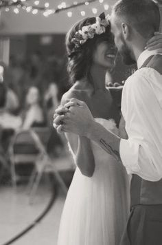 Beautiful wedding shot. Also, the hair is perfect. And the groom's outfit... and tattoo. :)