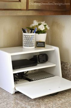 Turning a yard sale breadbox into a charging station to hide electronic clutter and mess in the kitchen. An easy DIY project to help organize all your device chargers and plugs.