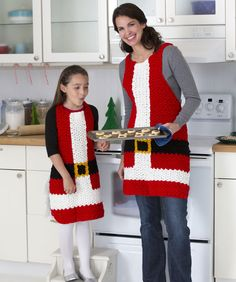 Santa's Aprons Crochet Pattern made with Super Saver yarn. You and your best helper will whip up cookies for Santa in no time when you don this special holiday apparel! So I know it's crochet, but I think for an apron, this would be better sewn. Crochet Santa, Christmas Crochet Patterns, Holiday Crochet, All Free Crochet, Crochet Crafts, Crochet Yarn, Crochet Hooks, Crochet Ideas, Diy Crafts
