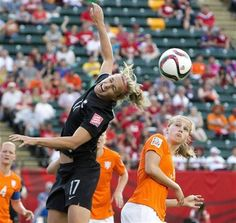 FILE - In this Saturday, June 6, 2015, file photo, Netherlands' Vivianne Miedema (9) and New Zealand's Hannah Wilkinson (17) battle for the ball during FIFA Women's World Cup game action in Edmonton, Alberta, Canada. (Jason Franson/The Canadian Press via AP, File) MANDATORY CREDIT ▼10Jun2015AP|US college players dot other nations' rosters at World Cup http://bigstory.ap.org/article/2d110575dfaa4bc7824b032aab55dc0f #2015_FIFA_Womens_World_Cup