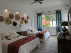 Guest bedroom with two queen beds and premium mattresses