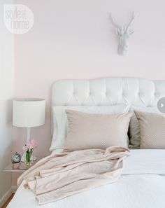 soft pink walls, tufted headboard, plush cream linens, white accessories = a perfect feminine bedroom