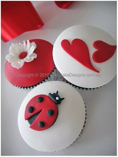 A beautiful cupcake design collection featuring a lady bug, hearts and a spring blossom.