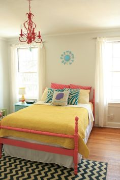 love the mix of fun colors with simple, neutral walls and window coverings. Coral, yellow, and aqua!!