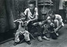 Emaciated father feeding Army rations to his son after he and his family were freed from a Japanese prison camp following the Allied liberation of the city, February 1945.  Photo credit: Carl Mydans / The LIFE Picture Collection O Donnell, Palawan, University Of Santo Tomas, Global Conflict, Leyte, Dust Bowl, Great Depression, Lest We Forget, World War Two