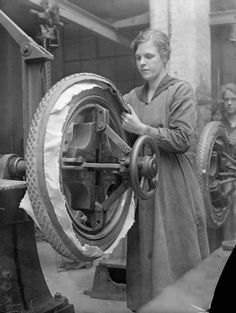 A female worker fixes a studded tread onto a motor vehicle tyre in the rubber factory of Charles Macintosh and Sons Ltd, Manchester, in September 1918.