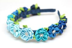 Plastic headband is weaved with satin ribbon. Flowers are made from grosgrain ribbons with Swarovski Crystals. Diameter of the flowers ~ 1.2 (3cm). All my creations are made with great care, using the finest materials. Each of my pieces is carefully designed and crafted. Please contact me