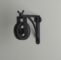 Image of Black Cast Iron Wall Bracket, Pulley and cleat