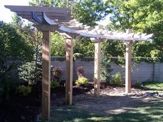 Beautiful, simple, curved pergola - slideshow of its construction at this site (Nature's Intent Landscaping, Utah)