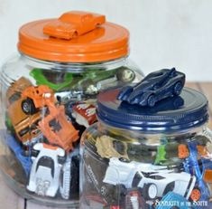 toy hot Hot Wheels Storage idea: A quick and easy craft project using Gorilla glue and spray paint to make a colorful toy car storage jar. Using this idea for my kids room to get it organized! Hot Wheels Storage, Toy Car Storage, Jar Storage, Storage Ideas, Playroom Storage, Bedroom Storage, Matchbox Car Storage, Storage For Toys, Kids Craft Storage
