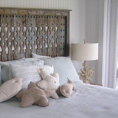 Jane Coslick Cottages : A few thoughts about Headboards.....i could make these pillows for our room....love the headboard!