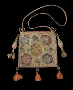 Linen sweet bag with silk embroidery, English, 1600–30  © CSG CIC This small bag is made of linen embroidered with multicoloured silk and silver threads with a sunflower, pink, borage, cornflower and rose. The flowers are worked in silk threads in detached buttonhole stitch with the curling stems in silver-gilt thread braid stitch against a background in silver threads embroidered in Gobelin stitch.