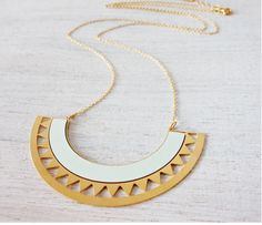 SOLARIS -A signature necklace with urban chic, inspired by cosmic wonders. Two geometric half moon shapes are linked to each other to create a bold pendant, hanging from a chain.