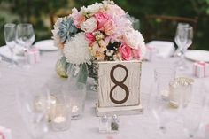 san juan capistrano wedding, wedding reception, romantic wedding inspiration, brown chivari chairs, pastels, succulents, dahlias, roses, garden ceremony, wood table numbers