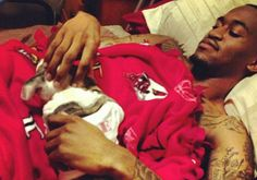 """Ware first broke the news of his dog via Instagram by posting, """"Welcome Scar to the Ware Family! We named him Scar to represent my struggle, and the 'scar' that will be left on my leg after the healing process.""""  He then continued to post, """"""""Scar so chill. My boy!""""  As you can tell from both photos, Ware and the dog are getting along nicely. Dogs make the perfect medicine don't they? It's great to see Ware is doing so well!"""