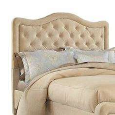 """Upholstered headboard with button tufting and nailhead trim.   Product: HeadboardConstruction Material: Wood and polyesterColor: BuckwheatFeatures:  Nailhead trimButton-tufting Dimensions: Queen: 50.25"""" H x 65"""" W x 4.25"""" DKing: 50.25"""" H x 80.25"""" W x 4.25"""" DNote: This product is a headboard only. Picture shows the full bed for illustration purposes only."""