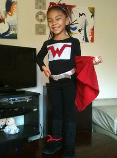 Super hero day at school! With scraps of fabric and an old red t-shirt I created this in under 30 minutes. She was a hit in school ;) - Sonia T.