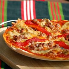 The most delicious ingredients combined in this pizza: roasted eggplant and red pepper, pork meat and the basics... give it a try!
