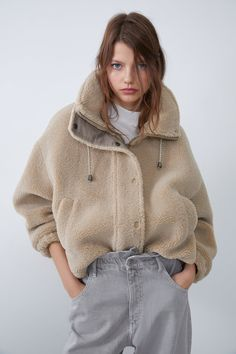 DESCRIPTION Faux Shearling Jacket With Contrast Trims cuz winter totally suxx. Stay warm AF in this faux shearling jacket that has high adjustable drawstring collar, front welt pockets, hidden zip and snap button closure. Faux Shearling Jacket, Fur Jacket, Style Board, Zara Australia, Jackets For Women, Clothes For Women, Mannequin, Mantel, Fashion Outfits