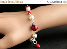 VALENTINE SALE Red Ladybug Bracelet. Lady Bug Charm Bracelet with Lampwork Glass Ladybugs Red Bead Accents and Glass Pearls. Handmade Brac by Gilliauna from Bits n Beads by Gilliauna. Find it now at http://ift.tt/2E8x2rp!