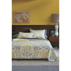 guest bedroom - yellow and gray with warm woods