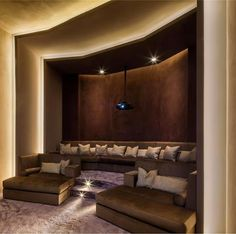 Media Room; love the seating but would utilize the center for viewing and put stairs up the sides