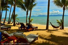 Maenam Beach, Koh Samui, Thailand. The island of Koh Phangan dominates the horizon beyond Maenam.