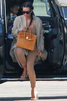 Kim Kardashian wearing Yeezy Spring 2016 Sandals and Hermes Suede Birkin Bag