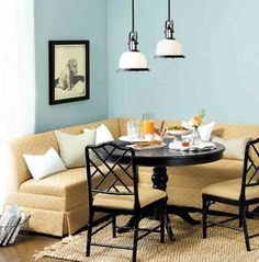 We paired a dijon colored banquette with a bold blue wall color  to create a relaxed dining banquette.