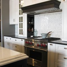 A picturesque kitchen with a backsplash feature wall in \'4100 ...