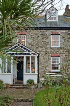 Stone exterior of Crantock farmhouse with glass porch Cornwall England UK Porch Uk, Cottage Porch, House With Porch, House Front, Outdoor Greenhouse, Backyard Greenhouse, Greenhouse Ideas, Small Greenhouse, Outdoor Planters