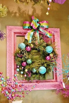 Christmas colorful wreath set within a pink picture frame.