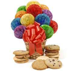 Happy Day Cookie Bouquet  These colorfully wrapped scrumptious cookies arranged in a wicker basket will make someone's day a little sweeter.  Happy Day Bouquet Includes two of each of the following:  • Chocolate Chip Cookies • Oatmeal Raisin Cookies • Sugar Cookies • Peanut Butter Cookies • MandM Cookies • White Chocolate Chip Cookies  Ships from OH - Standard Delivery $14.95 (2-5 Business Days)