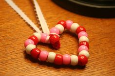 Pony Bead & Pipe Cleaner Heart Necklace.  I SO want to do this on Valentines Day with the kiddos at school!!