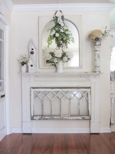 Old windows, fireplace mantel, etc. repurposed into a beautiful but reserved vignette