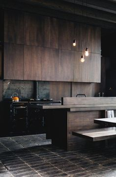 Combining a more rustic outdoor stone such as these slate bricks with reclaimed wood in a contemporary setting is very chic, fresh and masculine.