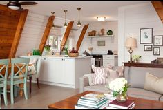 attic living room is nothing but bright and airy. The classic cottage look remained with the wood trim but a coat of calming white piles of books and lots of fresh blooms create a relaxing retreat. Cabin Kitchens, Cottage Kitchens, Diy Kitchens, Modern Kitchens, Black Kitchens, A Frame Cabin, A Frame House, Home Living Room, Living Room Decor