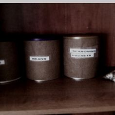 Repurposed baby formula cans as canisters.
