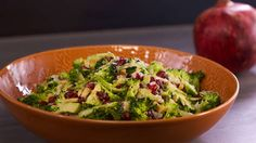 Shaved Broccoli Salad with Pomegranate Seeds and Grated Parmesan