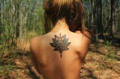 Image result for feminine upper back tattoos