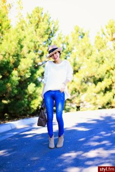 Hat with white sweater and denim pants with purse and long boots