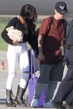 Selena Gomez.. American Apparel Cropped Sweater, Topshop Leigh Jeans, and Steve Madden Tropador Boots..... - Celebrity Fashion Trends