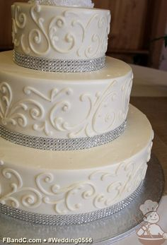 """Design W 0556   Butter Cream Wedding Cake   14""""+10""""+6""""   Serves 125   Crystal Mesh Band, Scroll Piping Design   Custom Quote"""