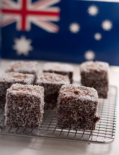 Australian Lamingtons Recipe for Australia Day. Aussies and Kiwis still battle over who brought out/invented the lamingtons and pavlovas first, haha. Australian Desserts, Australian Food, Australian Recipes, Cupcakes, Cupcake Cakes, Lamingtons Recipe, Australia Day Celebrations, Happy Australia Day, Aussie Food