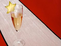 Give glasses of champagne some glitz with star fruit. You don't even need to peel the fruit - just slice and garnish.