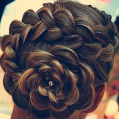 Dutch flower braid. Not sure why it's Dutch, but is is absolutely beautiful!!!