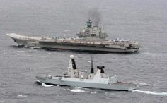 HMS Dragon (foreground), a Type 45 Royal Navy destroyer, escorting the Admiral Kuznetsov in the English Channel in 2014